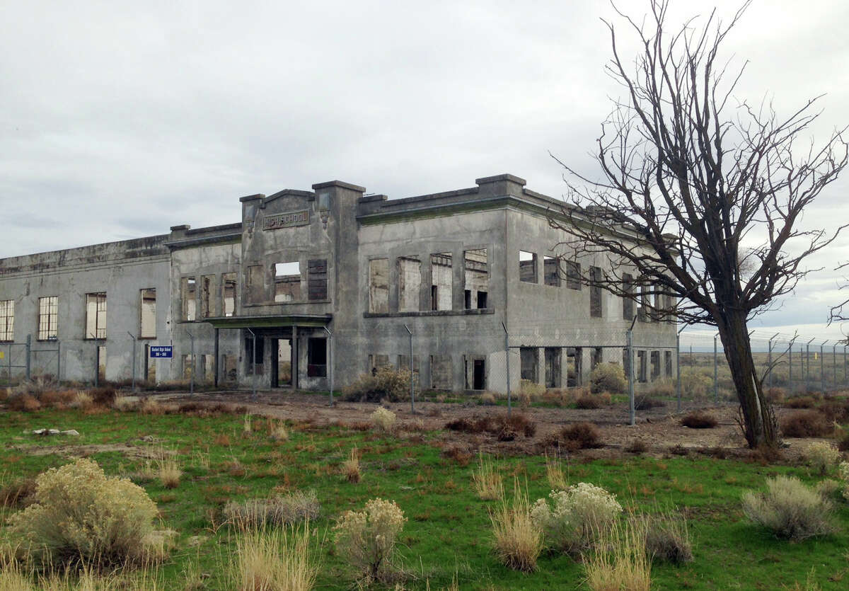 In this undated photo provided by the U.S. Department of Energy, the ruins of the old Hanford High School are shown near Richland, Wash. The towns of Hanford and White Bluffs were evacuated to make room for the Hanford Nuclear Reservation, which made the plutonium for the atomic bomb dropped on Nagasaki, Japan, and the ruins of the high school and other buildings are now part of the nation's newest national park, called the Manhattan Project National Historic Park.