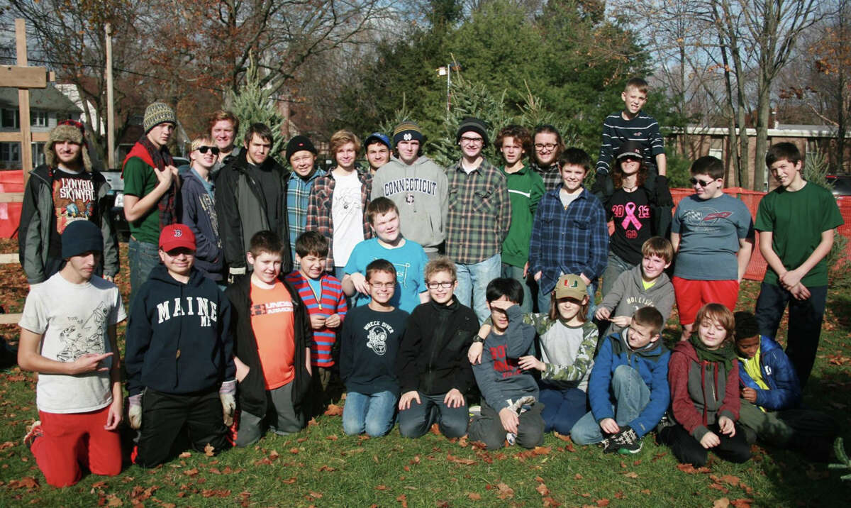 Members of Boy Scout Troop 608 at their Christmas tree sale in the parking lot of the Spring Glen Congregational Church on Whitney Avenue.