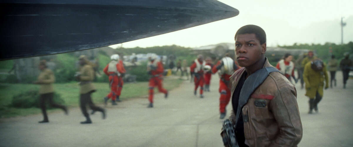 """This photo provided by Disney shows John Boyega as Finn, in a scene from the new film, """"Star Wars: The Force Awakens,"""" directed by J.J. Abrams."""