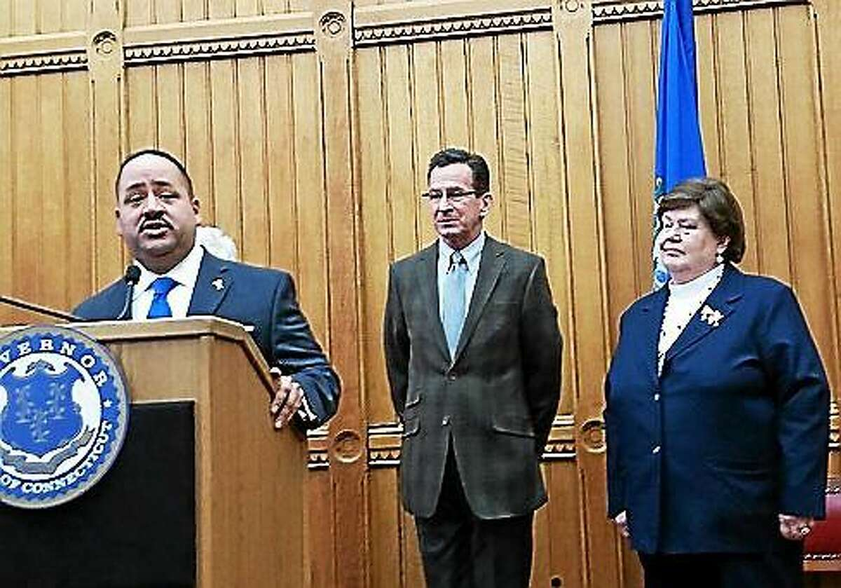 State Sen. Andres Ayala, left, speaks at a press conference Monday. Gov. Dannel P. Malloy, center, nominated Ayala to head the Department of Motor Vehicles, replacing its current commissioner Melody Currey, right.