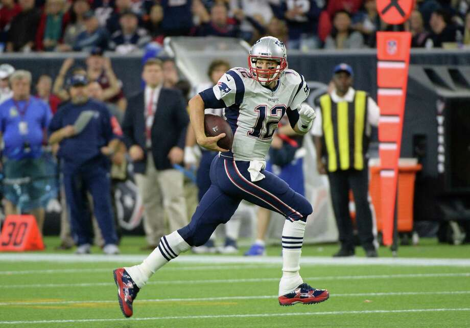 Quarterback Tom Brady and the Patriots can earn a first-round bye in the AFC playoffs with a victory today and a Broncos loss. Photo: The Associated Press File Photo  / FR171217 AP