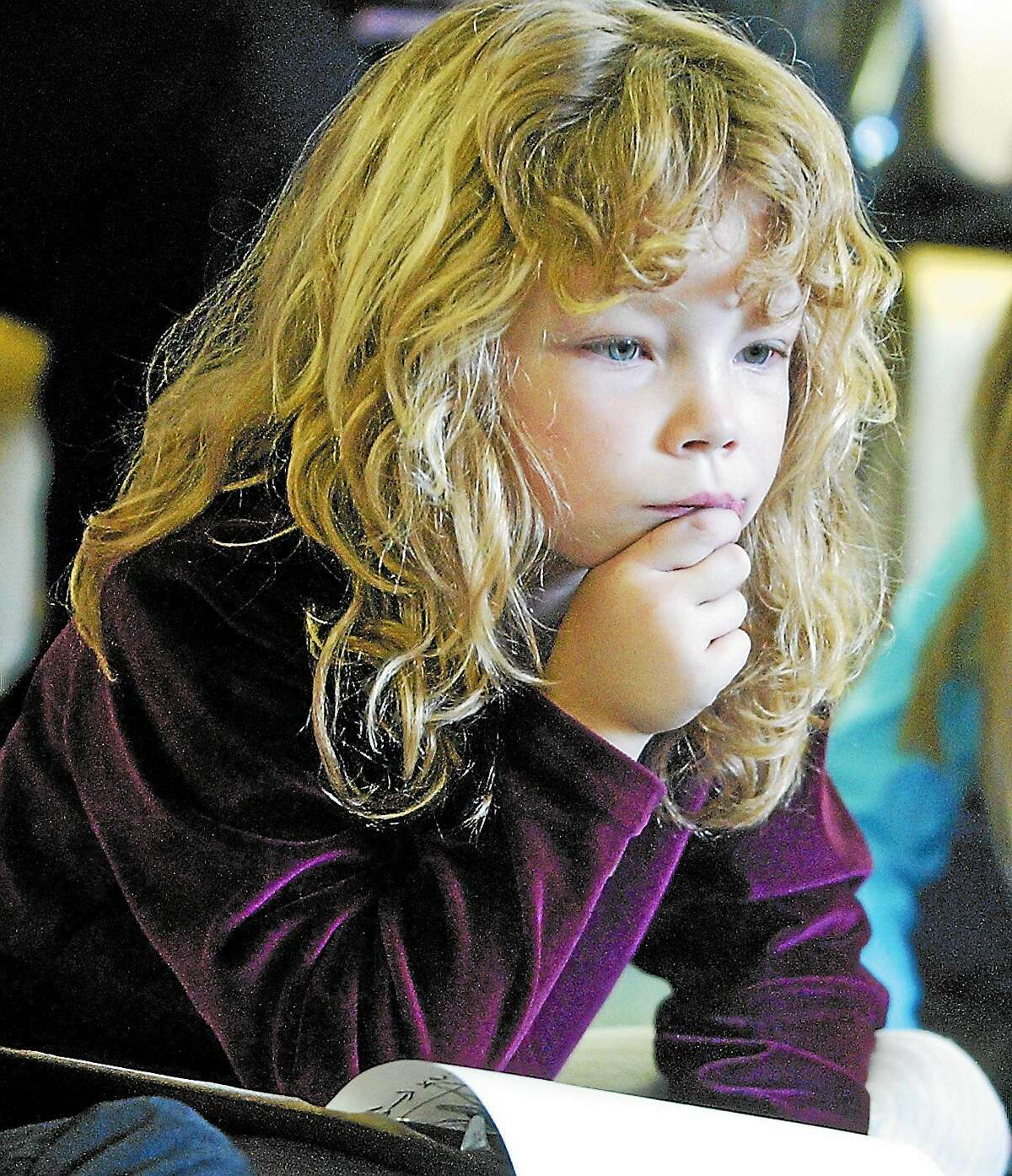 In this 2002 photo, John Lyman Elementary School first-grader Kelly Quinn listens to music while writing poetry in Middlefield.