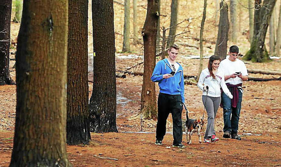 Billy Holt of Milford, 19, Ariell Muecko of Derby, 23, and John Longo of Yardsley, N.Y., left to right, stroll  down from Sleeping Giant State Park's Tower Trail  in Hamden Thursday, taking advantage of the springtime weather. Photo: Peter Hvizdak — New Haven Register  / ©Peter Hvizdak /  New Haven Register