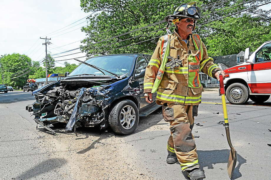 Olivia Drake - Special to the Press Three people were taken to the hospital following a two-vehicle, high-speed collision June 29 at the intersection of Saybrook Road and Thayer Road Extension in Higganum. Pictured is Haddam Firefighter Ron Annino at the scene of the accident. Photo: Journal Register Co.