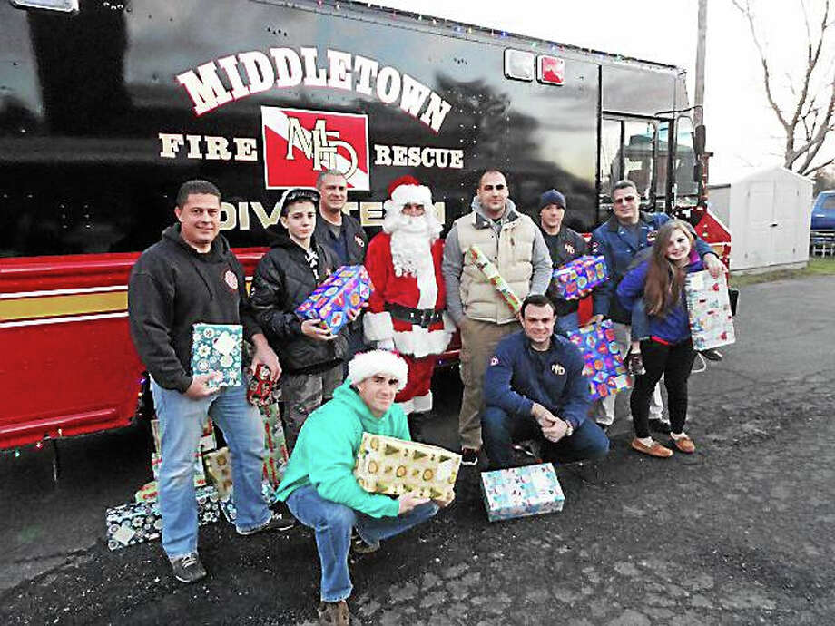 Cassandra Day - The Middletown Press Friday night Middletown firefighters from the Cross Street station packed up their engine trucks and a box truck full of donated Christmas gifts - at least 200, according to Battalion Chief Christopher Augeri - and Photo: Cassandra Day — The Middletown Press