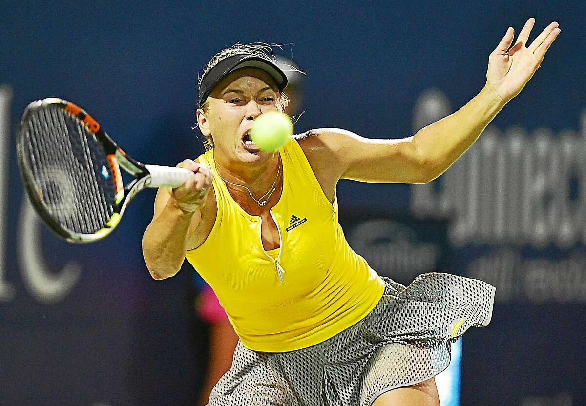 Caroline Wozniacki attempts to return a forehand to Petra Kvitova during her 7-5, 6-1 loss Friday night in the semifinals of the Connecticut Open.