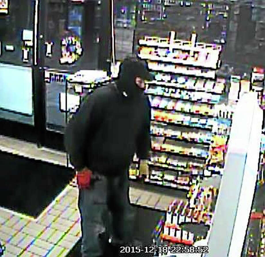 Surveillance showing suspect in robbery of convenience store in Branford Mobil station. Photo: Courtesy Of Branford Police Dept.