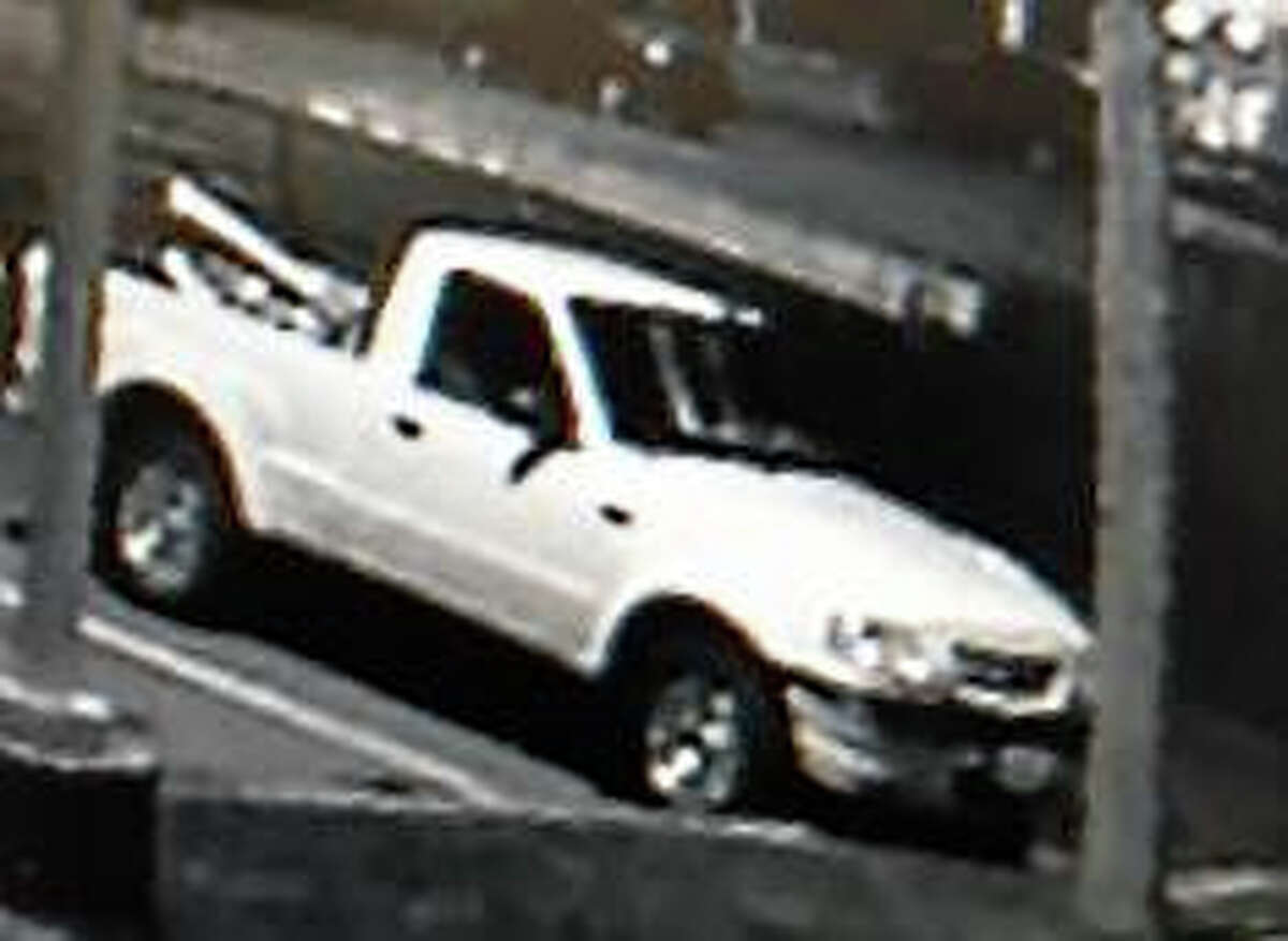 Surveillance showing truck that may have been driven by suspect in robbery of convenience store in Branford Mobil station.