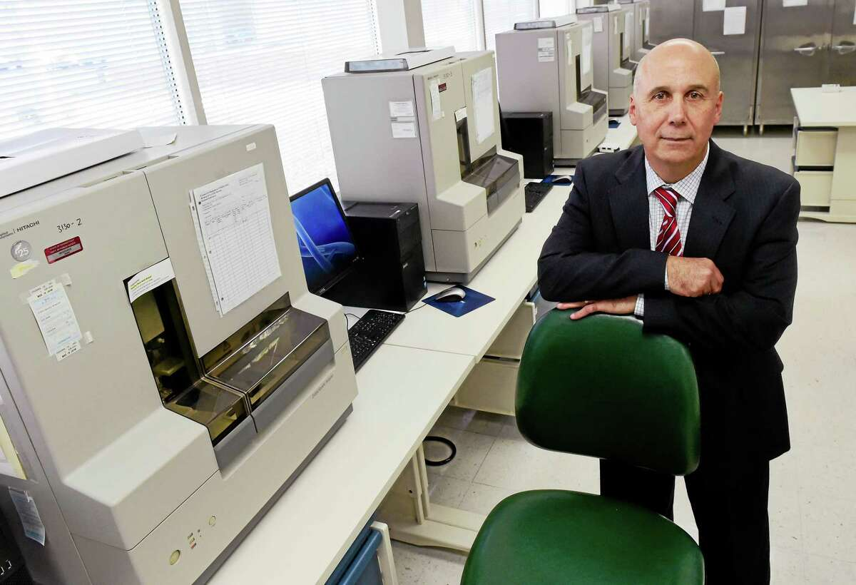 PETER HVIZDAK — NEW HAVEN REGISTER Guy M. Vallaro, director of the state Department of Emergency Services and Public Protection, Division of Scientific Services in Meriden, in the detection room where DNA is tested for a genetic profile.