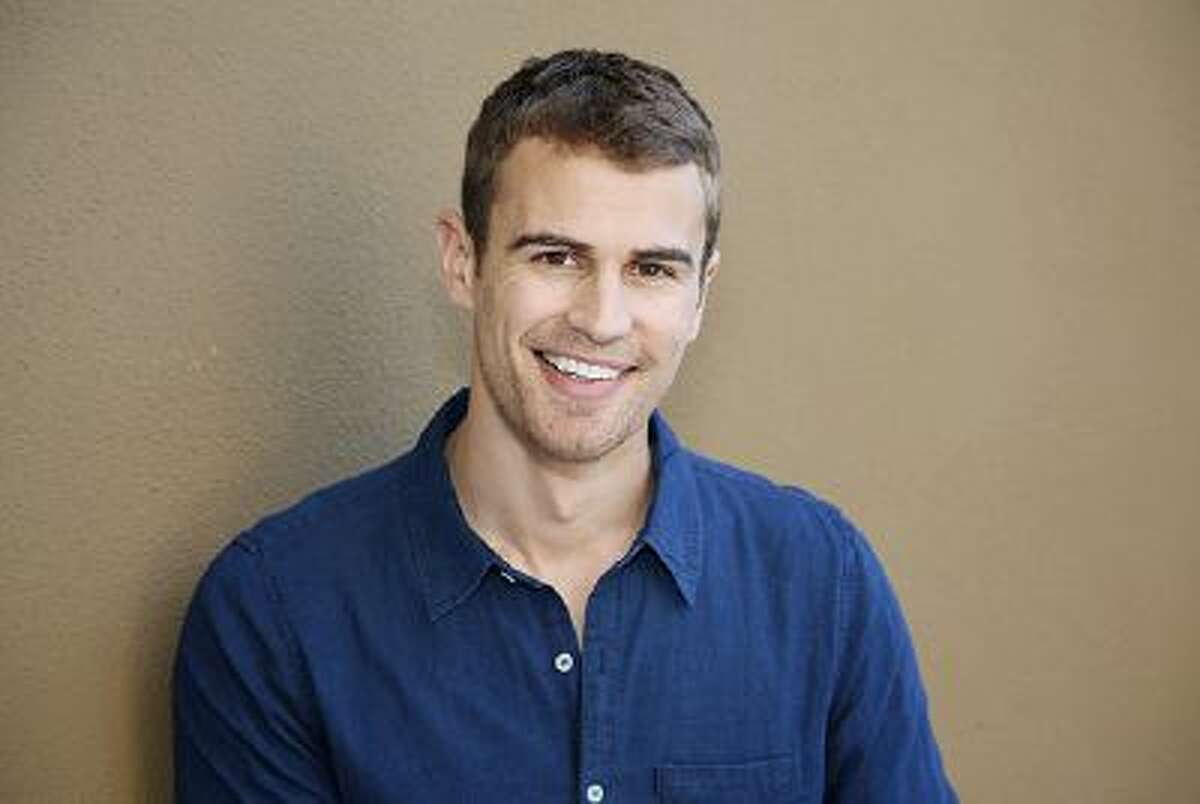 In this Saturday, March 8, 2014 photo, actor Theo James poses for a photo in Beverly Hills, Calif. The soulful Brit James, the star of the buzzed about