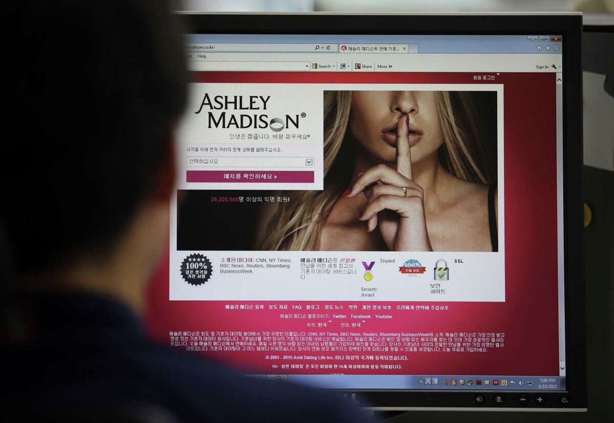 In this June 10, 2015, photo, Ashley Madison's Korean website is shown on a computer screen in Seoul, South Korea. Hackers claim to have leaked a massive database of users from Ashley Madison, a matchmaking website for cheating spouses. In a statement released Tuesday, Aug. 18, a group calling itself Impact Team said the site's owners had not bowed to their demands.