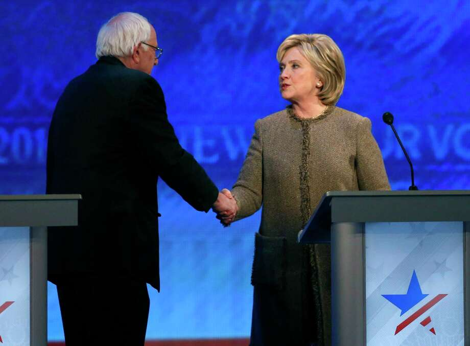Bernie Sanders, left, speaks to Hillary Clinton after a Democratic presidential primary debate Saturday, Dec. 19, 2015, at Saint Anselm College in Manchester, N.H. Photo: AP Photo/Jim Cole / AP