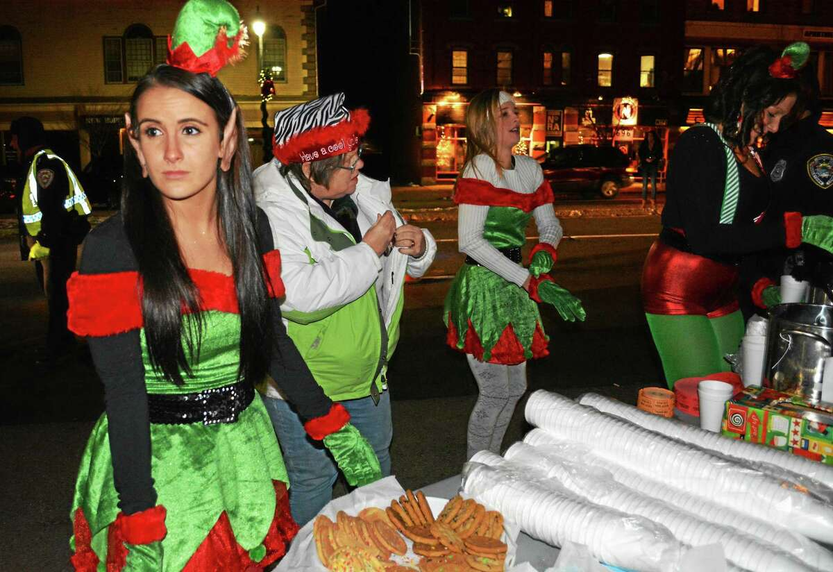 Bitter temperatures didn't deter large crowds of people from gathering downtown, from the South Green to Eli Cannon's in the North End, to enjoy hot chocolate, marching bands, visits with Santa, carols and three tree lightings during Middletown's annual Holiday on Main launch Nov. 28.