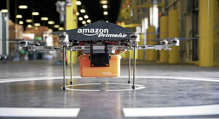 THE ASSOCIATED PRESS/AMAZONAn Amazon octocopter delivery vehicle. Photo: Journal Register Co.