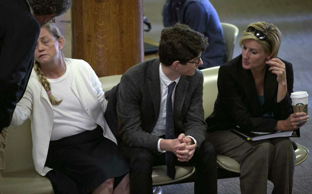 Owen Labrie talks with one of his attorneys Jaye Rancourt, right, as his parents Denise Holland and Cannon Labrie talk in the lobby as they wait outside the courtroom for the verdict in his trial at Merrimack County Superior Court on Friday, Aug. 28, 2015 in Concord, N.H. Labrie is charged with raping a 15-year-old freshman as part of Senior Salute, in which seniors try to romance and have intercourse with underclassmen before leaving the prestigious St. Paul's School in Concord.
