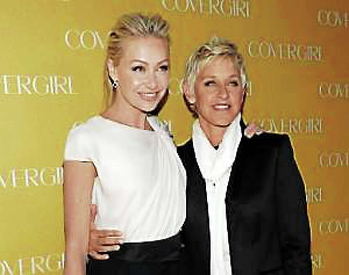 In this Jan. 5, 2011, file photo, television personality Ellen DeGeneres, right, and actress Portia de Rossi arrive at the COVERGIRL Cosmetics' 50th Anniversary Party in Los Angeles.