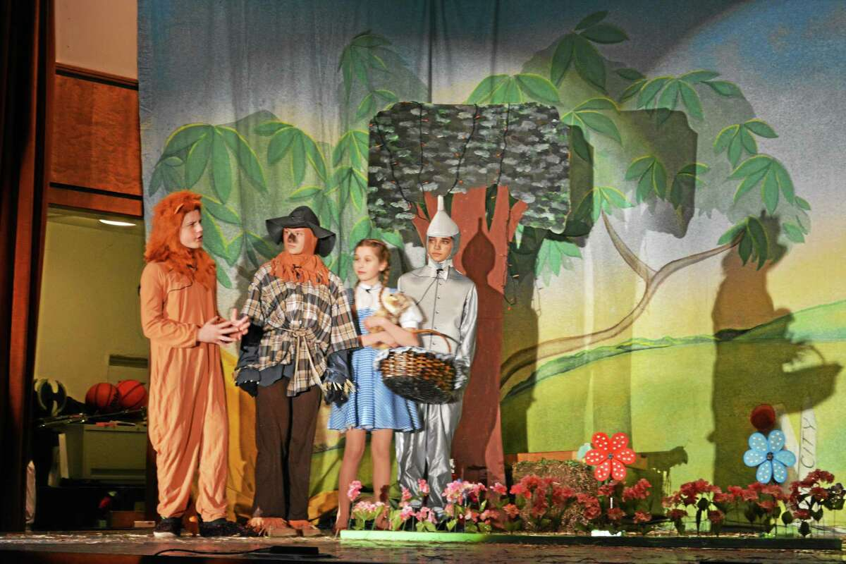 "St. John Paul II students Alyssa Rondinone, Jordyn Beck, Linda Brown and Aiden Cardozo arrive in Emerald City in the school's performance of ""The Wizard of Oz."""