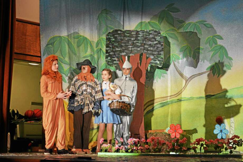 "St. John Paul II students Alyssa Rondinone, Jordyn Beck, Linda Brown and Aiden Cardozo arrive in Emerald City in the school's performance of ""The Wizard of Oz."" Photo: Brian Zahn — The Middletown Press"