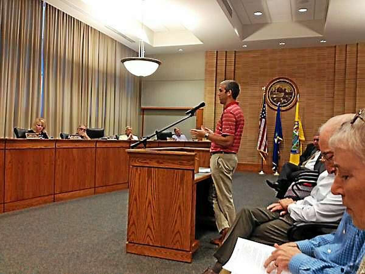 Middletown Soccer Coach Zach Eddinger speaks to the Common Council earlier this week on how he supports placing artificial turf in city parks and school fields.