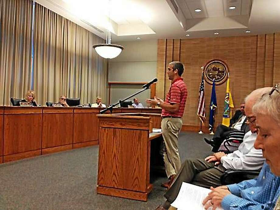 Middletown Soccer Coach Zach Eddinger speaks to the Common Council earlier this week on how he supports placing artificial turf in city parks and school fields. Photo: Brian Zahn — The Middletown Press