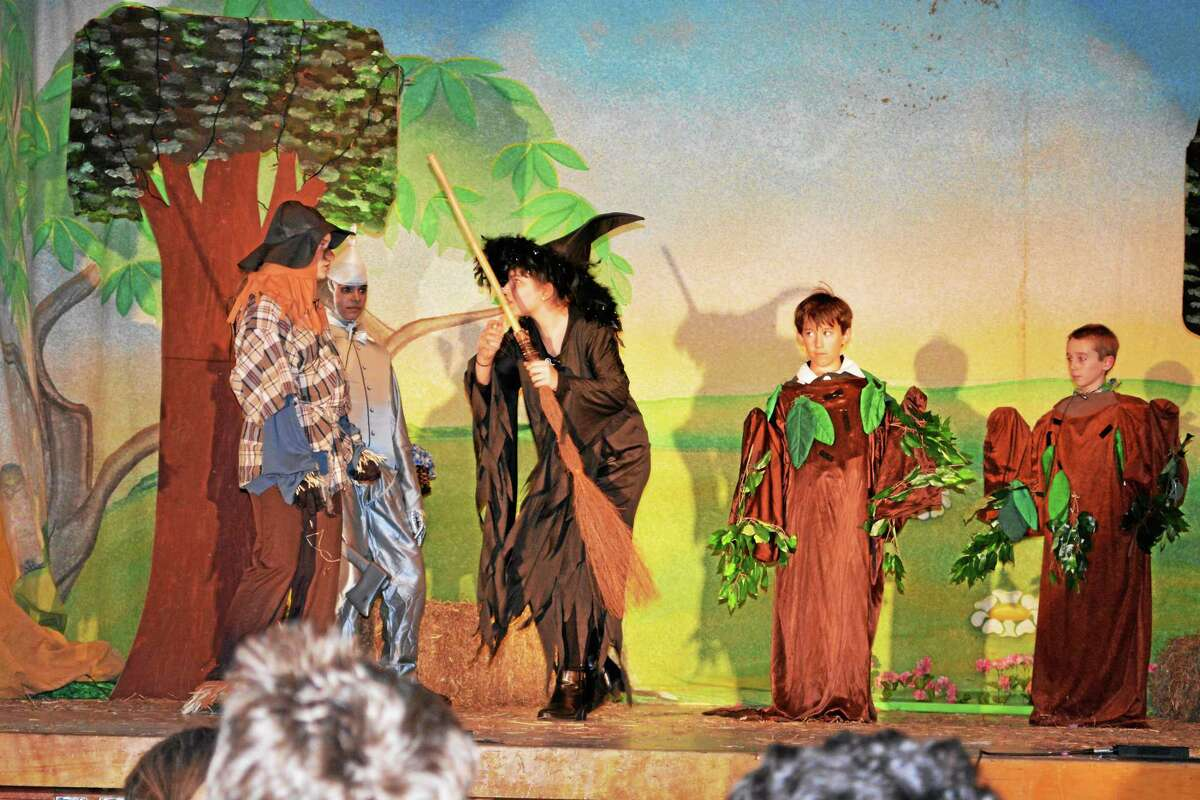 "St. John Paul II students Alyssa Rondinone, Lorenza Inserra, Jordyn Beck and Linda Brown stage a scene from ""The Wizard of Oz"" during their final rehearsal before the April 24 performance."