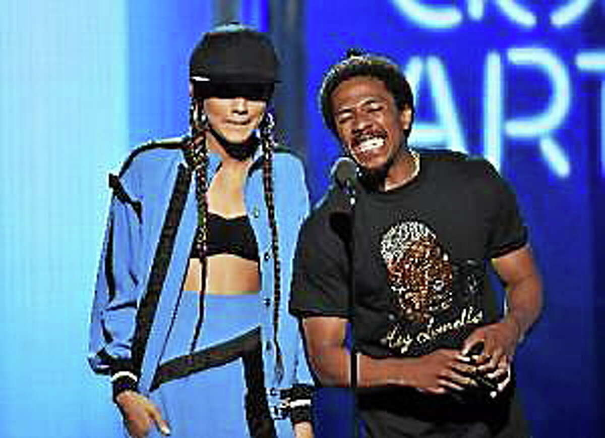 Actress Zendaya and TV personality Nick Cannon speak onstage during the BET Awards '14 at Nokia Theatre on June 29, 2014 in Los Angeles, California.