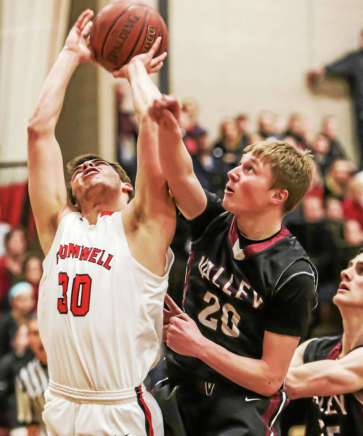 Cromwell's Logan Lessard goes up strong for a jump shot, but is fouled by Valley's Evan Smith.