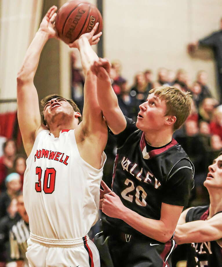 Cromwell's Logan Lessard goes up strong for a jump shot, but is fouled by Valley's Evan Smith. Photo: John Vanacore — Special To Press  / John Vanacore/Middletown Press