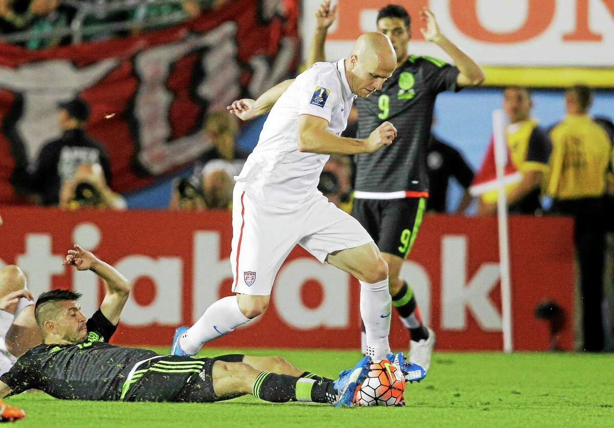 Mexico's Oribe Peralta, on the ground, attempts to take the ball from the United States' Michael Bradley during a CONCACAF Cup match in October at the Rose Bowl in Pasadena, Calif.