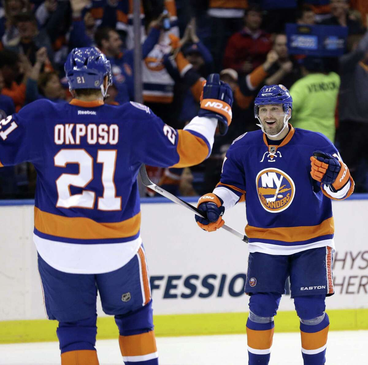 The New York Islanders' Lubomir Visnovsky celebrates with Kyle Okposo after Okposo scored during Game 3 Sunday against the Washington Capitals in Uniondale, New York.