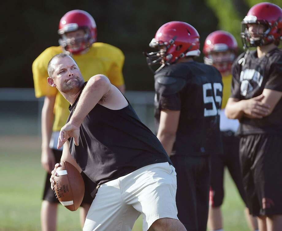 Cromwell head coach Chris Eckert works with the return specialist at football practice Friday afternoon. Photo: Catherine Avalone — The Middletown Press  / The Middletown Press