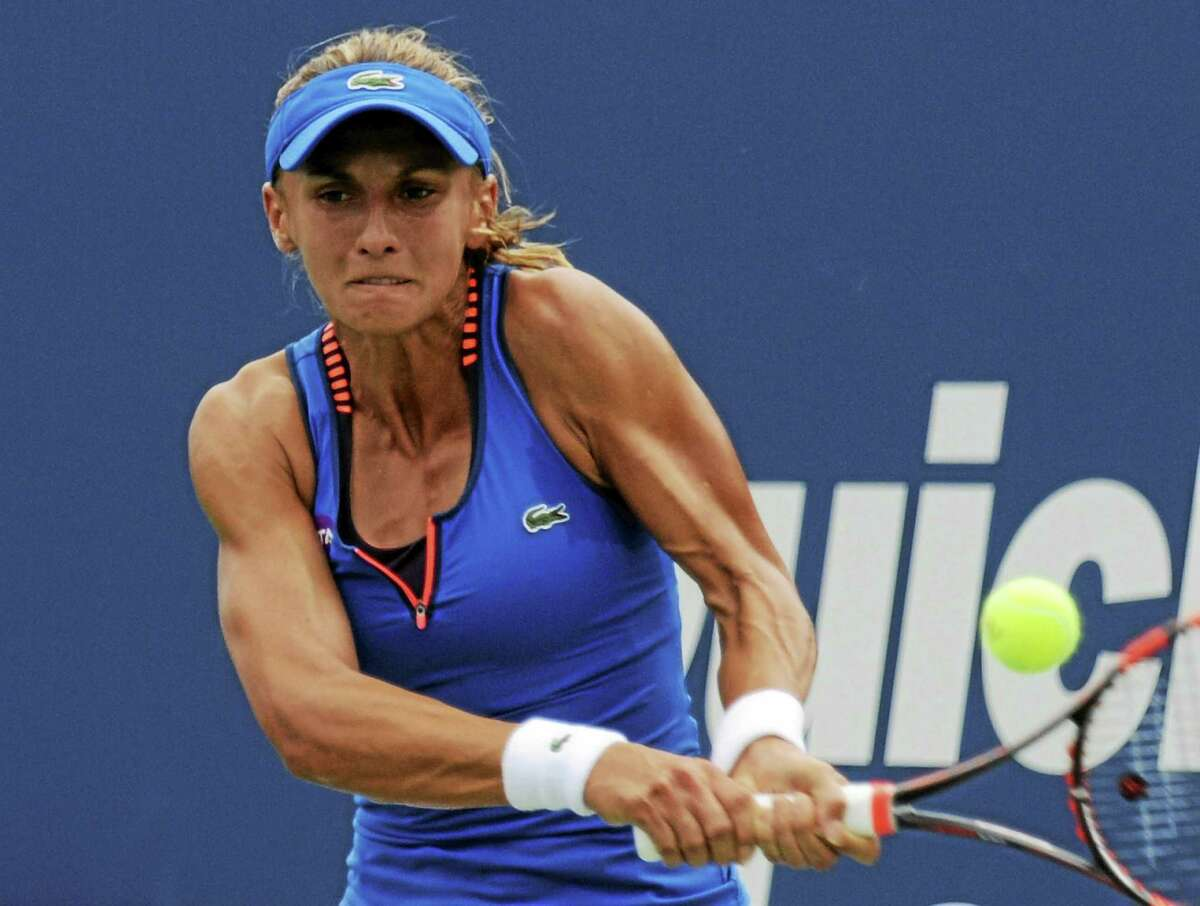 Lucky loser Lesia Tsurenko hits a return to No. 5 seed Karolina Pliskova during Thursday's quarterfinal match at the Connecticut Open in New Haven.