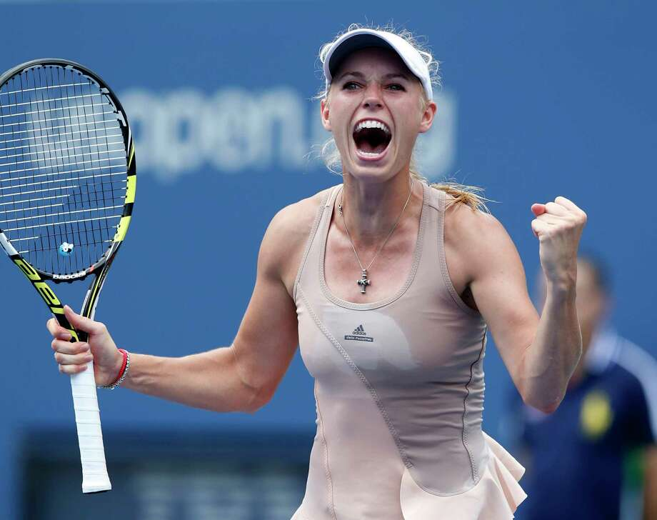 Caroline Wozniacki reacts after defeating Maria Sharapova during the fourth round of the U.S. Open on Sunday. Photo: Kathy Willens — The Associated Press  / AP