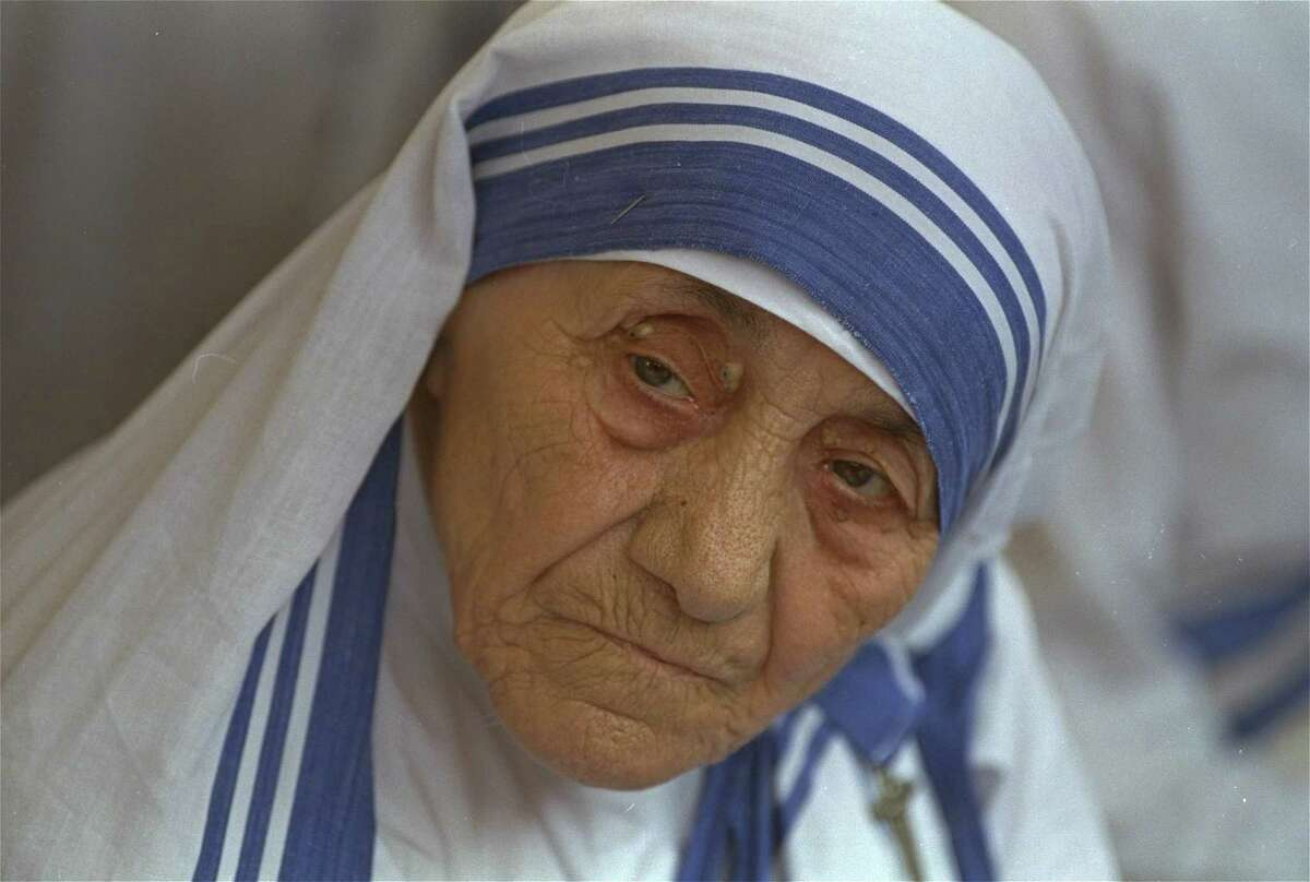 In this Aug. 25, 1993 file photo Mother Teresa, head of Missionaries of Charity, is photographed, in New Delhi, India. Pope Francis has signed off on the miracle needed to make Mother Teresa a saint, giving the nun who cared for the poorest of the poor one of the Catholic Church's highest honors just two decades after her death. The Vatican said Friday, Dec. 18, 2015, that Francis approved a decree attributing a miracle to Mother Teresa's intercession during an audience with the head of the Vatican's saint-making office on Thursday, his 79th birthday.