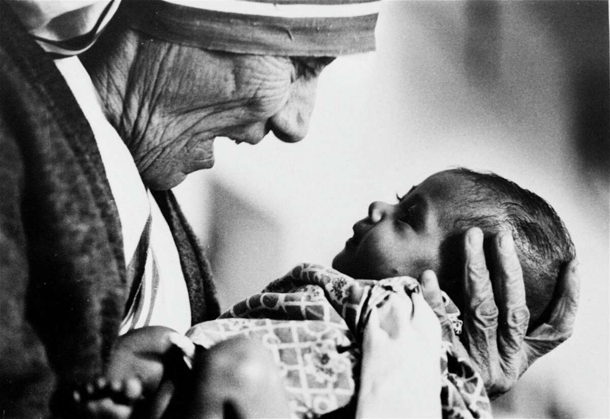 In this 1978, file photo, Mother Teresa, head of the Missionaries of Charity order, cradles an armless baby girl at her order's orphanage in what was then known as Calcutta, India, in 1978. Pope Francis has signed off on the miracle needed to make Mother Teresa a saint, giving the nun who cared for the poorest of the poor one of the Catholic Church's highest honors just two decades after her death. The Vatican said Friday, Dec. 18, 2015, that Francis approved a decree attributing a miracle to Mother Teresa's intercession during an audience with the head of the Vatican's saint-making office on Thursday, his 79th birthday.