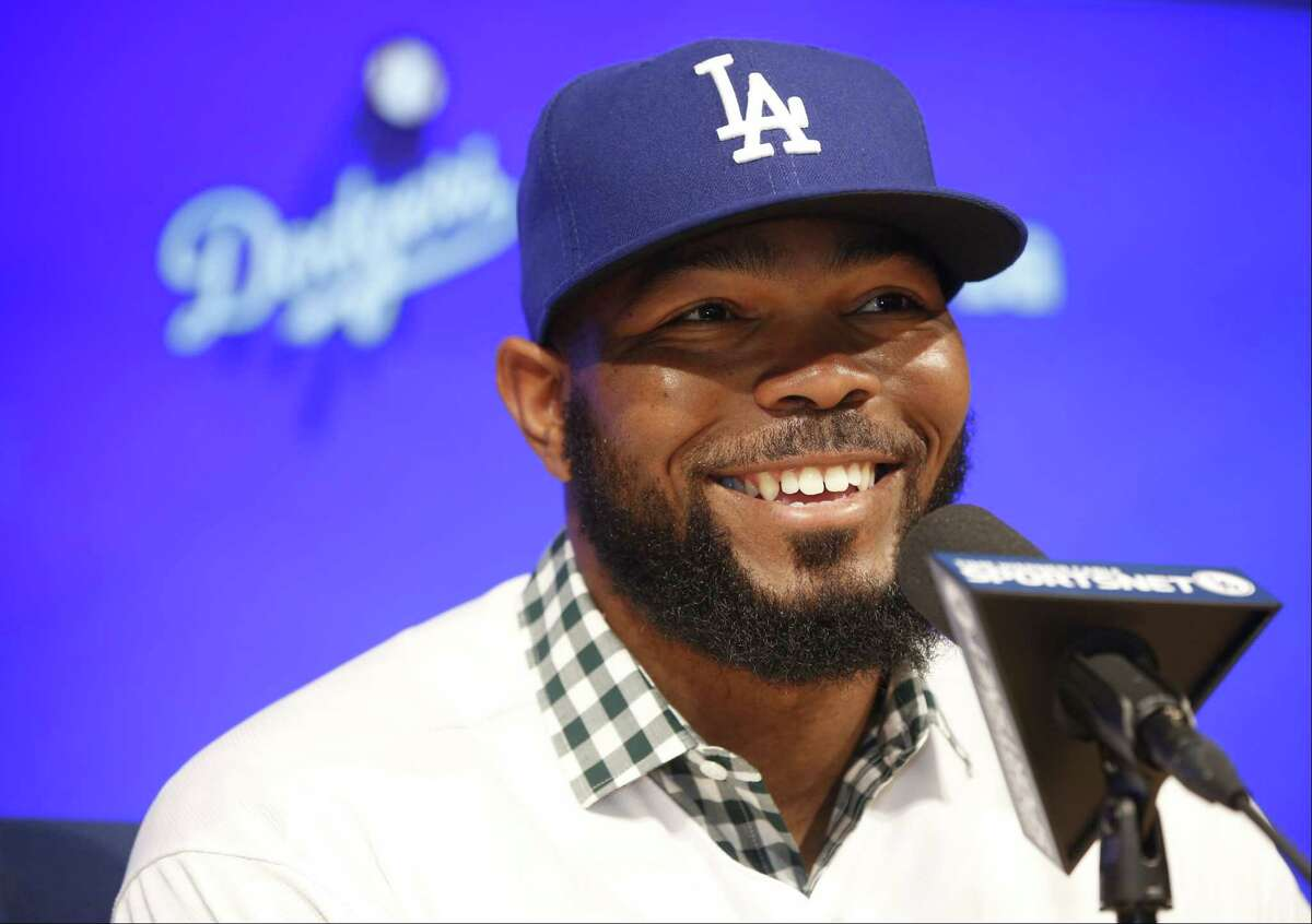 Los Angeles Dodgers baseball player Howie Kendrick takes questions from the media at an introductory news conference at Dodger Stadium in Los Angeles on Dec. 19, 2014.