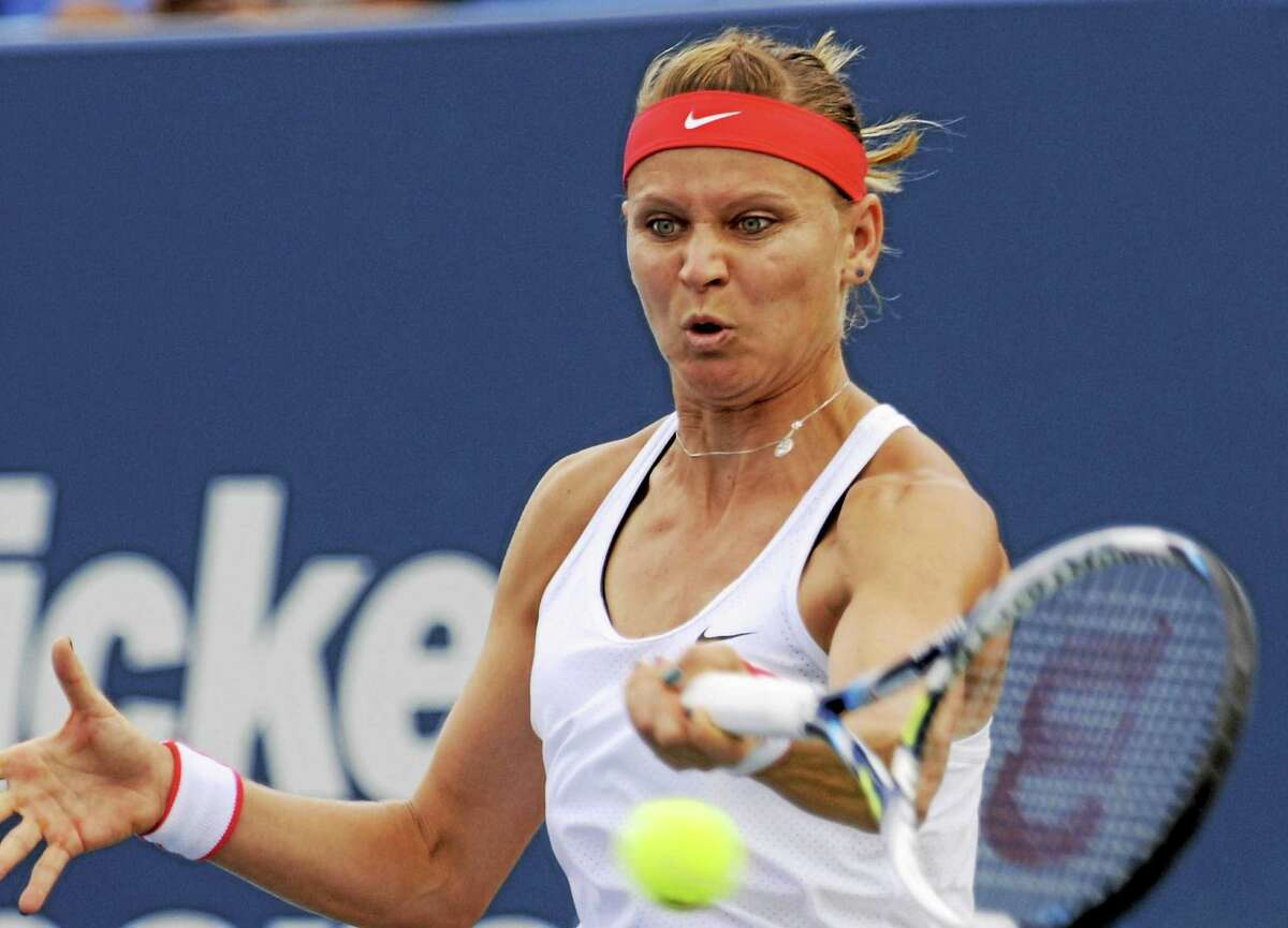 Lucie Safarova hits a forehand return against Dominika Cibulkova on Thursday at the Connecticut Open in New Haven.