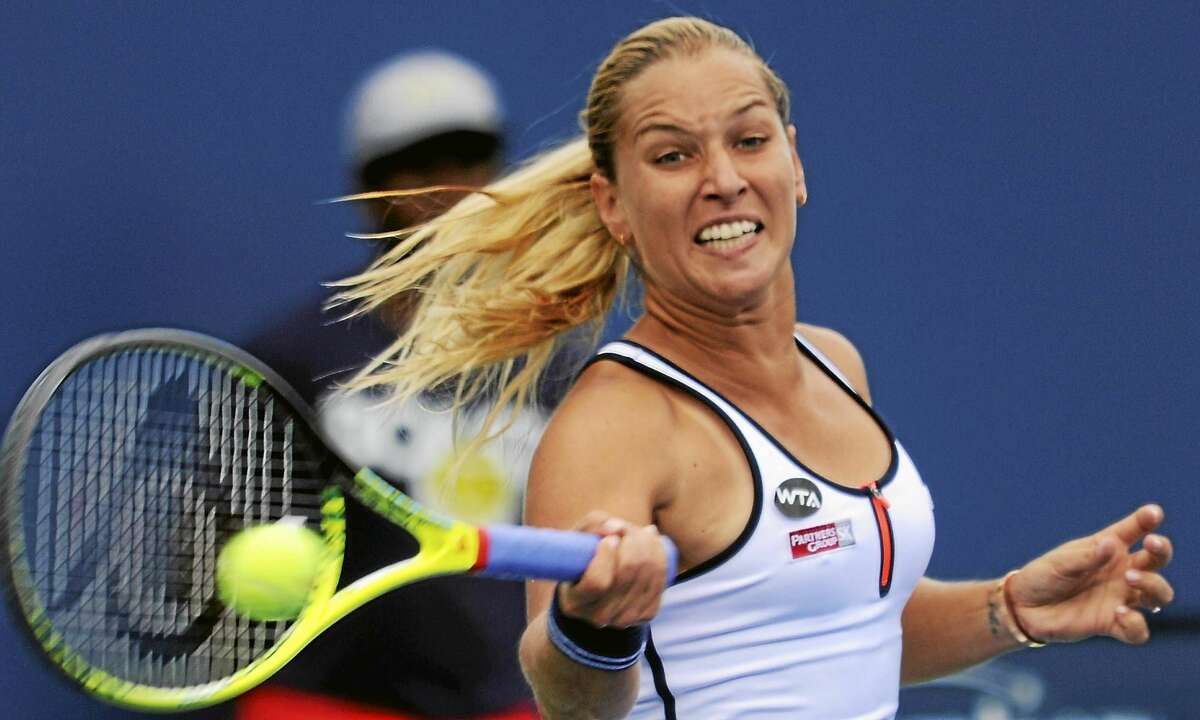 Dominika Cibulkova hits a forehand to Lucia Safarova Thursday at the Connecticut Open in New Haven.