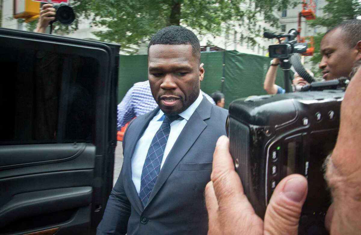 FILE - In a Tuesday, July 21, 2015 file photo, rapper Curtis Jackson, also known as 50 Cent, leaves court after testifying in front of the jury about his finances, his business deals and the media attention surrounding his recent bankruptcy filing, in New York. Rapper 50 Cent has lowered the asking price for his Connecticut mansion again after filing for bankruptcy in the state this past summer. The Hartford Courant reports the new listing for 50 Cent's 21-bedroom, 25-bathroom home in Farmington is $8.5 million.
