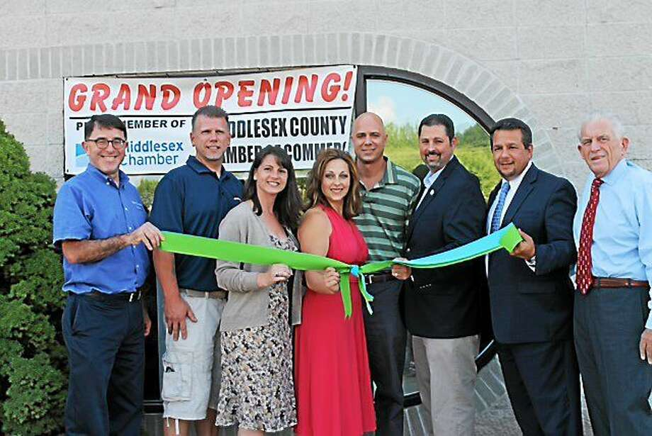 From left are Cromwell Town Planner Stuart Popper, Rodney Bitgood of Cromwell Automotive, state Rep. Christie Carpino, Alicia Berger-Harriman of Stretch, Jon Harriman, Cromwell Mayor Enzo Faienza, Chamber Chairman Rich Carella and Chamber President Larry McHugh. Photo: Submitted Photo