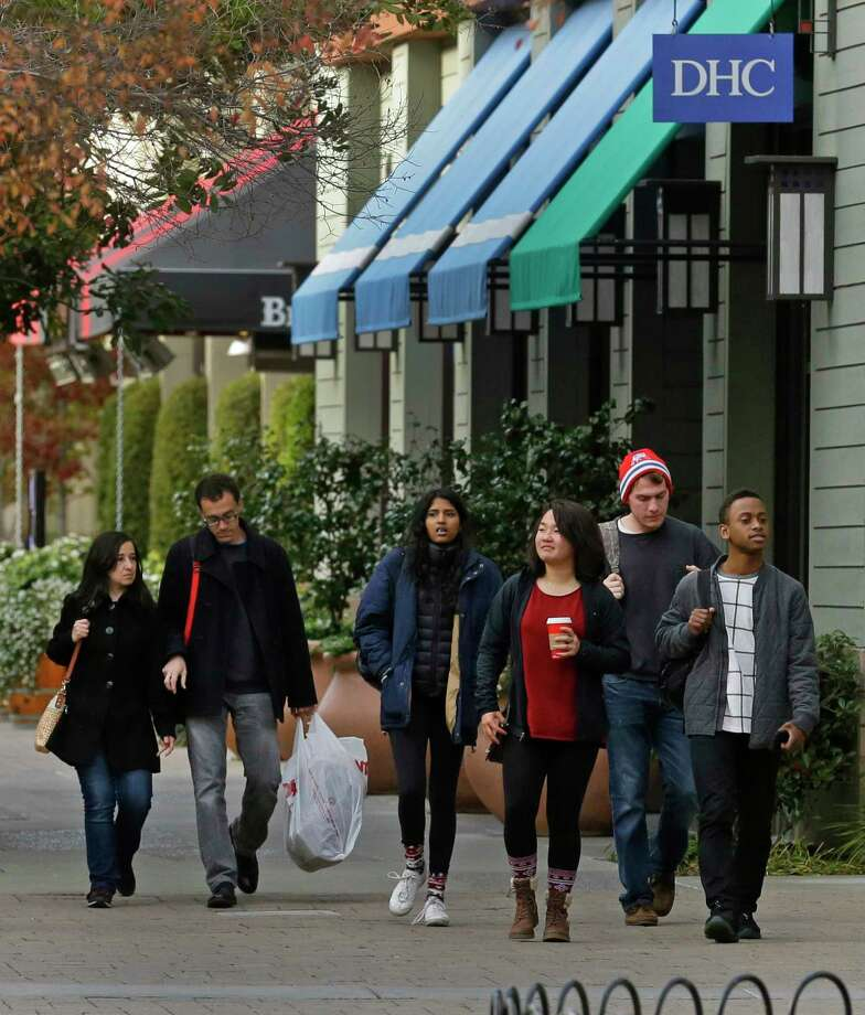 Shoppers walk through an outdoor mall Thursday, Dec. 17, 2015, in Alameda, Calif. (AP Photo/Ben Margot) Photo: AP / AP