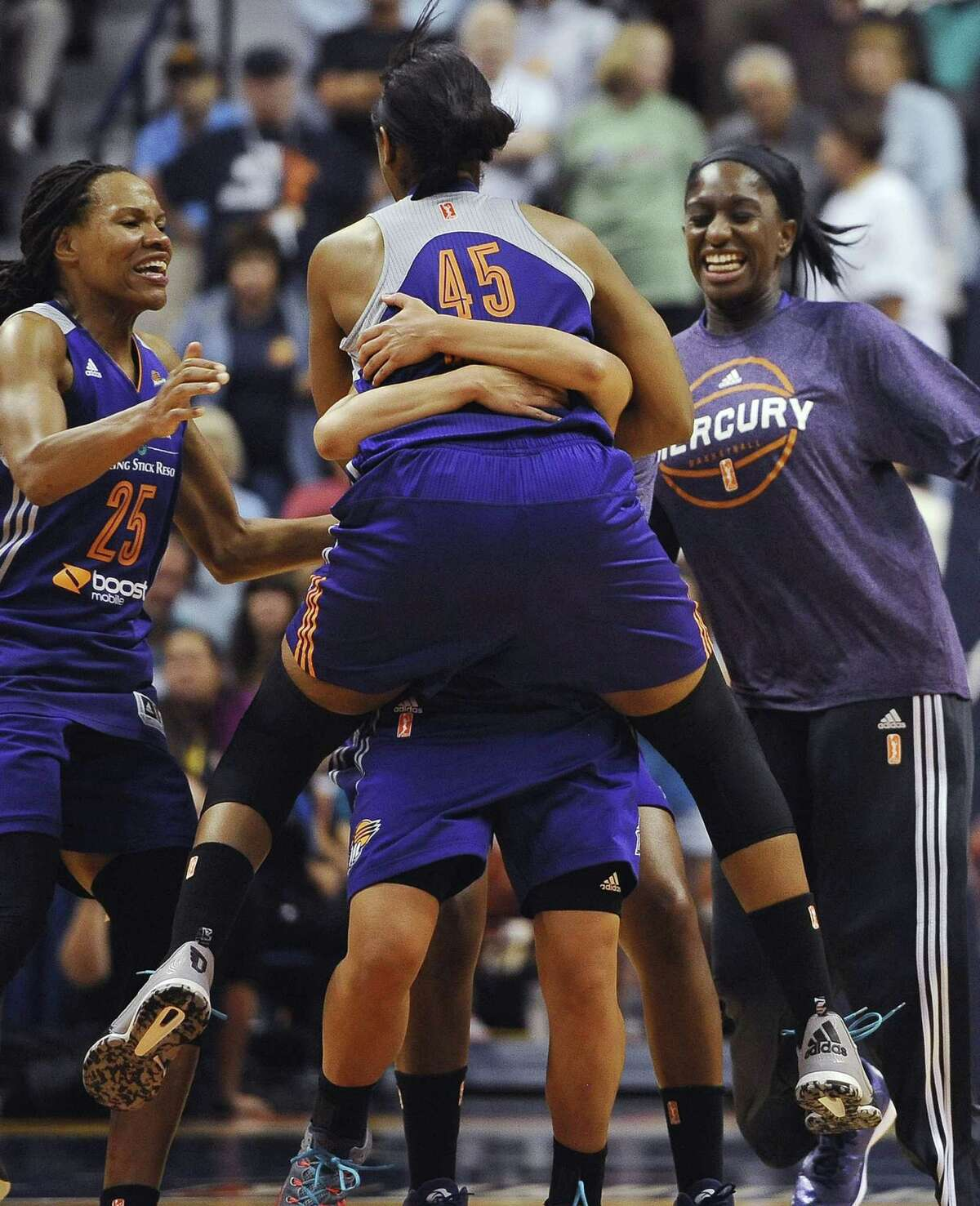 The Phoenix Mercury's Noelle Quinn (45) jumps into the arms of Leilani Mitchell after Mitchell hit the game-winning 3-pointer at the buzzer against the Connecticut Sun on Thursday in Uncasville.