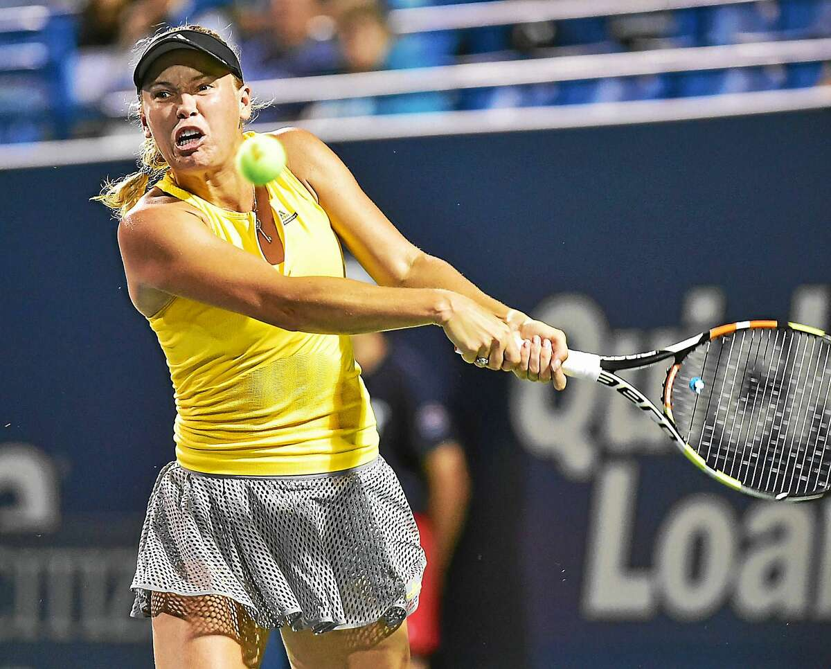 Caroline Wozniacki defeated Caroline Garcia on Thursday to reach the semifinals of the Connecticut Open.