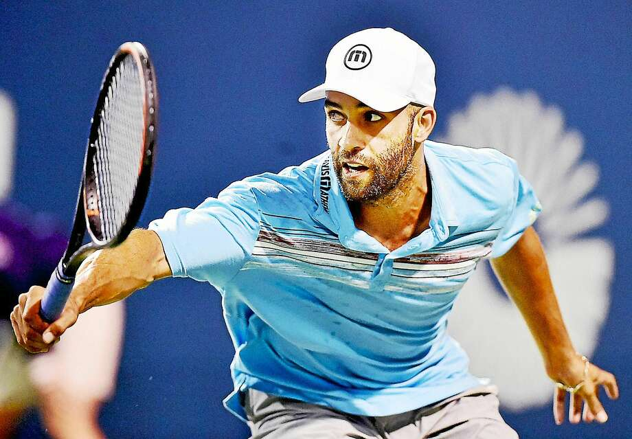 James Blake defeated Andy Roddick 7-5, 6-4 in the men's legends match on Thursday night at the Connecticut Open in New Haven. Photo: Catherine Avalone — Register  / New Haven RegisterThe Middletown Press