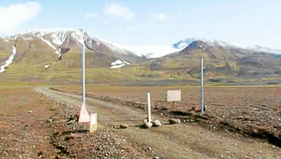 """In an in an image from an Aug. 19, 2014 video, a sign is posted on the road next to Bardarbunga, a subglacial stratovolcano located under Iceland's largest glacier.The English portion of the sign reads, """"Uncertainty phase due to unrest in Bardarbunga."""" Photo: AP Photo/Courtesy Channel 2 Iceland  / AP2014"""