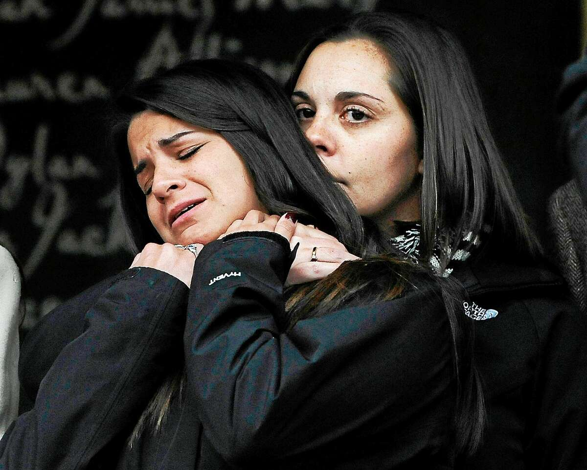 (AP Photo/Jessica Hill) Erica Lafferty, daughter of Sandy Hook Elementary School shooting victim, Dawn Hochsprung, right, consoles Carlee Soto, sister of victim Victoria Soto after families representing fourteen families addressed the media on Dec. 9, 2013, in Newtown, Conn.