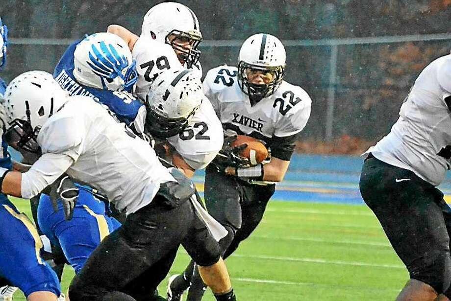Xavier running back Glenn Cunningham (22). Photo: GameTime CT Photo