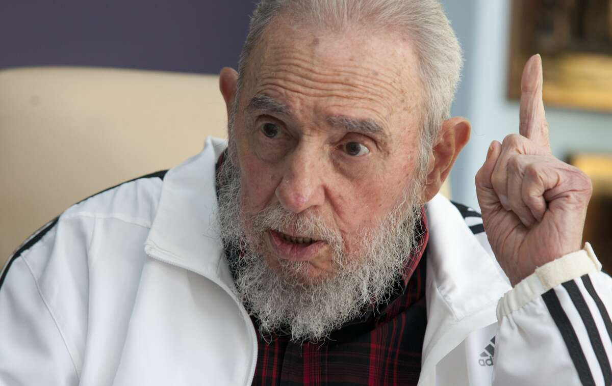 FILE - In this July 11, 2014 file photo, Cuba's Fidel Castro speaks with Russia's President Vladimir Putin in Havana, Cuba. Amid the excitement over the thaw in U.S.-Cuba relations, one person has been conspicuously absent: Fidel Castro. The former Cuban president hasnít made any public comment about the announcement that the U.S. and Cuba will restore diplomatic relations after more than 50 years of hostility.(AP Photo/Alex Castro, File)