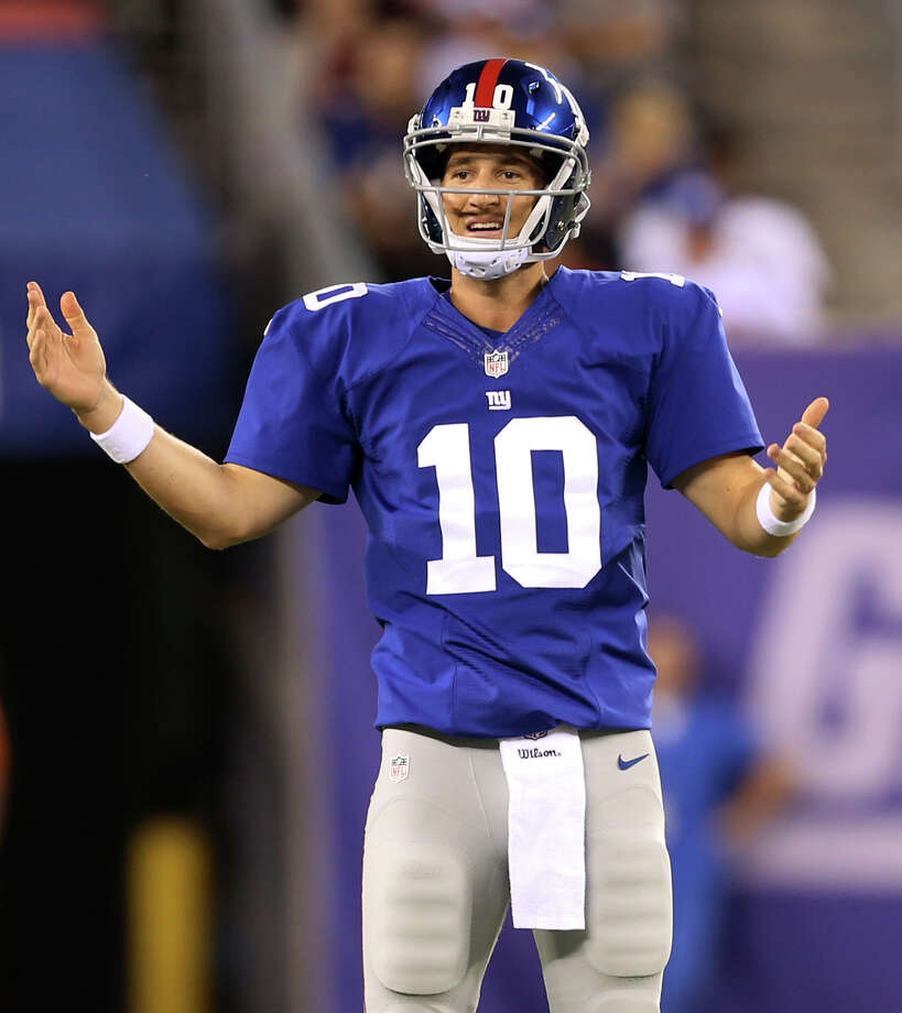 Eli Manning will need to play better than he did in the preseason if the Giants are to end their two-year playoff drought. Photo: John Minchillo — The Associated Press  / FR170537 AP