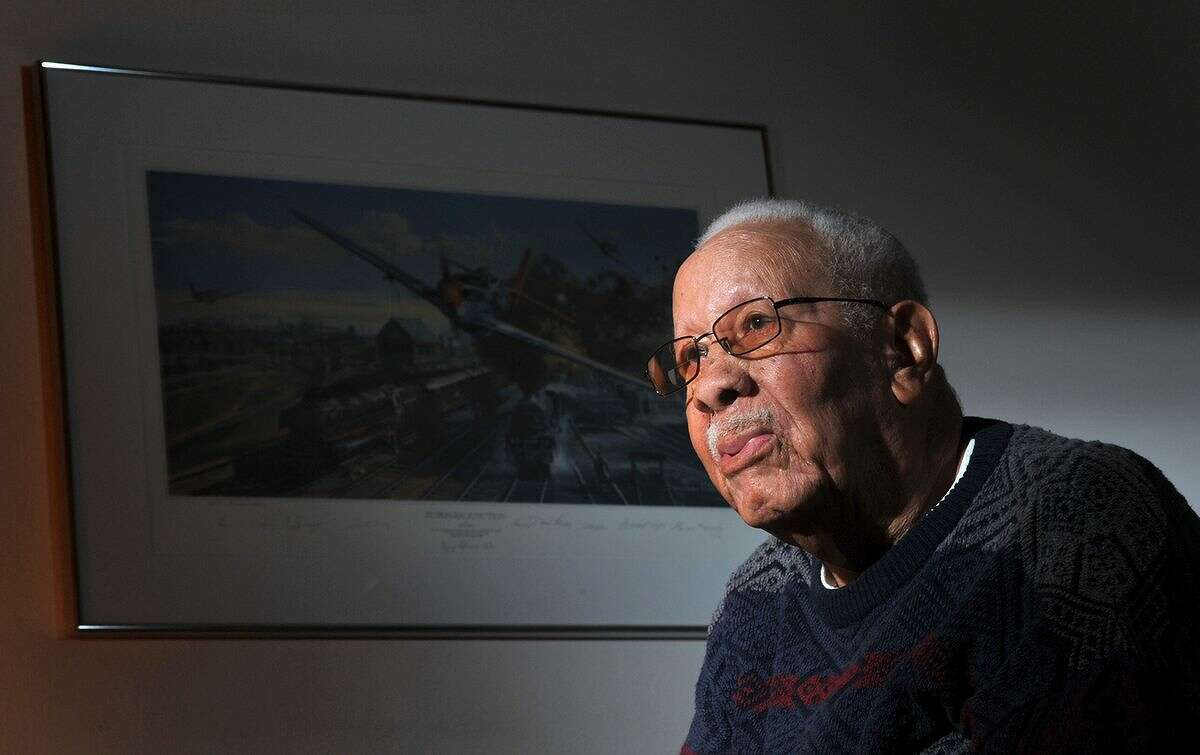 In this Feb. 14, 2012 photo, Lowell C. Steward, 92, poses for a photo, in Oxnard, Calif. Steward, a former member of the Tuskegee Airmen who flew nearly 200 missions over Europe during World War II, died Wednesday, Dec. 17, 2014, in California. He was 95. (AP Photo/The Ventura County Star, Joseph A. Garcia) LOS ANGELES DAILY NEWS OUT